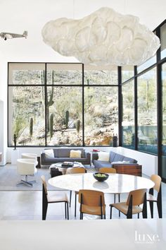 A broad expanse of glass framing the space the owners call their sitting lounge opens to the site's saguaro forest. The pair of Milo Baughman rosewood-cased sofas were purchased separately. The marble-topped table is a midcentury classic by Eero Saarinen. Dining Room Design, Dining Room Furniture, Best Dining, Eclectic Decor, Living Area, Living Rooms, Home Renovation, Luxury Homes, Contemporary