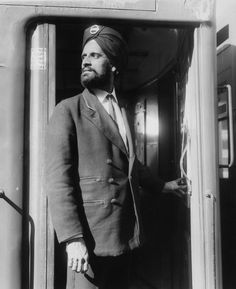 3rd September 1964: Amar Singh, a sikh who works for London Underground, has been allowed to pin his badge to a turban after a protest against having to wear the standard uniform hat. Hulton Archive / Getty