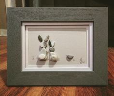 #pebbleart #bunnies #gettingreadyforeaster #eastergift #nurserydecor #kidsroomdecor #naturalmaterials
