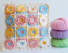 Crochet flower granny square pillow by dada's place, via Flickr