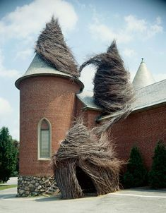 I adore the way these natural sculptures interact with the architecture. They seem alive.  by Patrick Dougherty