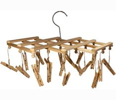 This could easily be made with one of those mug racks, string, and clothespins - it's an underwear drying rack. Cool!