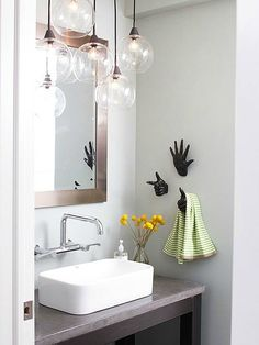 Love a chandelier in the bathroom - and those towel holders!