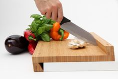 Magisso Cutting Board -- Available at SuburbanFoodies.com   With its unique Z shape, the board is stable to use against the edge of the counter.  The back ridge of the board gives extra support for the knife and keeps food from falling.