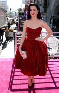 We love Katy Perry's red velvet Dolce & Gabanna gown that makes her purple hair POP!