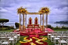 Flower Aisle, outdoor mandap, acrylic mandap with yellow flowers, Indian wedding decor