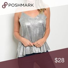 🐰Silver metallic peplum top Silver metallic strap peplum top. Polyester/Spandex blend  Sizes: Small (fits 2-4), Medium (fits 6-8), Large (fits 10-12) Tops Tank Tops