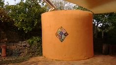 My concrete water tank- it looked very bare so I did a quick mosaic before I limewashed it.. It's inspired by a Kaffe Fassett design.