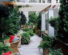 A Terrific Terrace Plants and a pergola contribute to a lively rooftop. Plants and hardscape elements can define areas of a rooftop that are more or less exposed. Here, a pergola and plants shield the space from overhead and one side. Terrasse Design, Balkon Design, Outdoor Rooms, Outdoor Gardens, Outdoor Living, Rooftop Gardens, Rooftop Terrace, Terrace Garden, Terrace Ideas