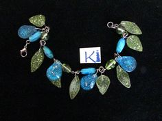 Green Leaf and Blue Turquoise Orgone Resin Bracelet Stainless Steel by KiCrystalCreations on Etsy Clear Quartz, Quartz Crystal, Resin Bracelet, Bracelets, Crown Chakra, Resin Crafts, Stainless Steel Bracelet, Anklets, Glass Beads