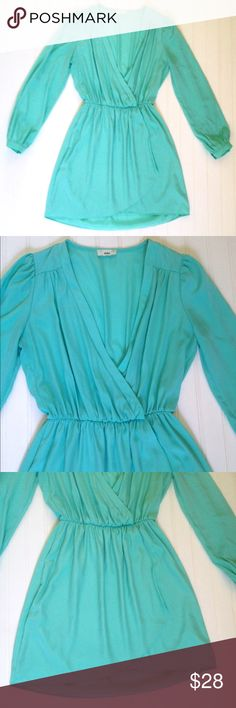"""Tobi long sleeve mint green That's a Wrap dress Bought via Lulu's, Tobi's That's a Wrap dress in mint green has a deep V empire neckline that drapes a little at the elastic waist before finishing with a layered tulip bottom. Sheer and gauzy long sleeves have mother-of-pearl buttons at wrists. Looks great with a belt or as a stand alone piece. Juniors size S, but may fit M because of elastic at waist. Bust: 16"""" flat across. Waist: 11"""" unstretched. Length: approx 32"""". Nearly new--worn once…"""