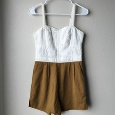 """NWT Anthropologie Eyelet Romper Cute piece and looks great on! Perfect condition and the material is top quality. Never worn. Would look great for summer!! 3"""" inseam. Has pockets. Machine wash. Slash front pockets and back zipper. Anthropologie Pants Jumpsuits & Rompers"""