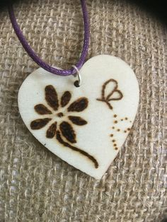 A personal favourite from my Etsy shop https://www.etsy.com/uk/listing/525947412/heart-shaped-flower-butterfly-wooden