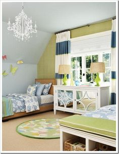 Striped curtains.  Love the thin accent color and how it is incorporated throughout the room.
