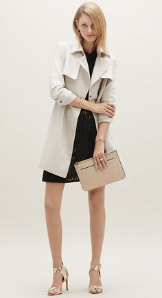 Pair a trench with a flirty skirt and heels for a night out.