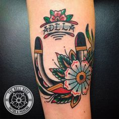 Horseshoe and flower tattoo made by Frank Fontanez at The Bell Rose Tattoo & Piercing in Daphne, Alabama.