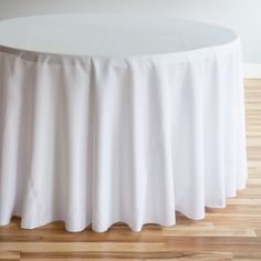 Shop for round tablecloths at LinenTablecloth. Our 120 in. Round Polyester Tablecloth White features a surged hem, seamless design, and durable fabric quality ideal for withstanding high-volume banquet events and restaurants. White Round Tablecloths, Wedding Tablecloths, Wedding Linens, Wedding Decor, Rustic Wedding, Linen Tablecloth, Table Linens, Elegant Table, Wedding Receptions