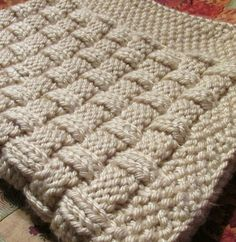 Knitting Pattern for Quick Basket Weave Baby Blanket - This easy blanket of knit and purl stitches makes a quick fluffy blanket in bulky yarn.
