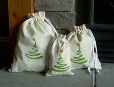 reusable cloth christmas bags | Handpainted fabric gift bags, Nikki Designs , $20 for 3 (Etsy)