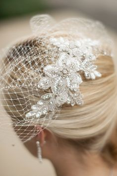 Love this short birdcage veil. It would coordinate well with wedding dresses that have intricate beaded floral detail without overpowering the look.