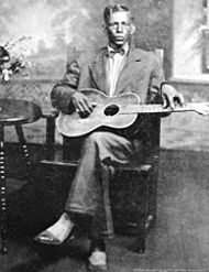 """Charley Patton ( April 1887 and 1891 – April 28, 1934), also known as Charlie Patton, was a Delta blues musician. He is considered by many to be the """"Father of the Delta Blues"""", and is credited with creating an enduring body of American music and personally inspiring just about every Delta blues man. Musicologist Robert Palmer considers him among the most important musicians in America.  This picture is the only known picture of him to exist. Note his finger placement on the neck of the…"""