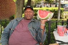 "Pitkin Avenue Street Scene  Joe Ellis and his partner Jerome live in the community and can be found on Pitkin Avenue every day selling fresh watermelons, mangos and more. ""The community is developing and coming together,"" Joe says. We welcome you...BECOME A HOMEOWNER!"