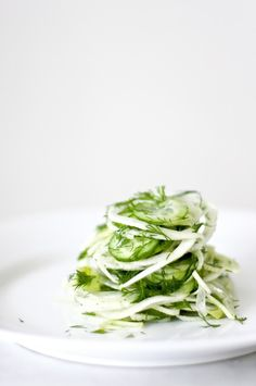 Simple, delicious Fennel Slaw with dill, cucumber and Meyer Lemon. Refreshing and light, this pairs very well with simple roasted salmon.   www.feastingathome.com # fennel #fennelslaw