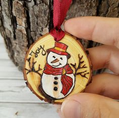 Wood Slice Christmas Decoration; Burned and Painted Ornaments perfect for Rustic Christmas Gifts; Christmas Tree Ornaments with Snowman / Deer / Penguin and ispiring Wishes  Our beautiful wooden ornaments are handmade out of real acacia tree. No tree was cut down to create these ornaments! They are not factory made but artist designed and created from a tree branch that had fallen down. Me and my boyfriend cares about the environment! The autentic design is achieved through wood bur...