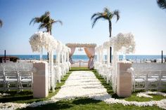 Luxurious wedding ceremony on ocean view lawn of Hotel Del Coronado