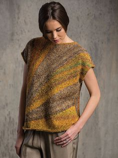 "This lightweight top is great for sporting in the spring or summer, or layering in the fall and water. Knit with 5 (6, 7) balls of Filatura Di Crosa Tempo using a U.S. size 6/4mm 24"" circular needle and 2 size 4/3.5mm 24"" circular needles. ..."