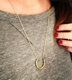 horseshoe necklace + red manicure.