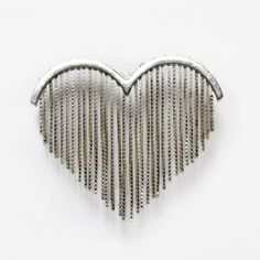 A brooch by Tanja Emmert in the form of a love heart.