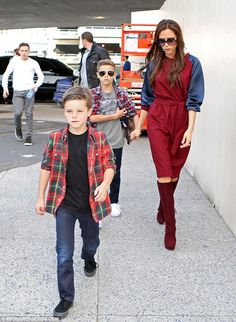 David and Victoria were spotted at LAX with their four children as they prepared to go back home for the holidays.