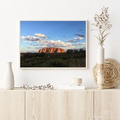 This picture shows the Uluru (Ayers Rock) in the red center of Australia illuminated in the last sunrays of the day. A magical place showing a piece of ancient history fused with the powerful colours of Australia. Photography Pricing, Framing Photography, Landscape Photography, Nature Photography, Australia Landscape, Ayers Rock, Crystal Clear Water, Beach Print, Landscape Prints