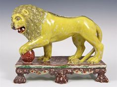 Rare early nineteenth century Obadiah Sherratt-type Staffordshire pearlware 'Roaring Lion', the l