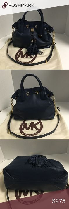 NWT Michael Kors Camden drawstring leather satchel This is a beautiful new Michael Kors Camden navy leather satchel with drawstring. Snap closure for main compartment. Detachable 24 inch shoulder strap. Also adjustable. Gold tone hardware. Inside lining is beige signature. Zipper pocket and two slip pockets inside. Key fob.  New with tag and dust bag Michael Kors Bags Satchels