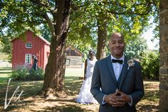 bride and Groom's first look in front of historic out buildings
