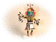 The beautiful Eagle Kachina sometimes appears at night ceremonies in March along with the Mud Heads. Description from artlegends.org. I searched for this on bing.com/images