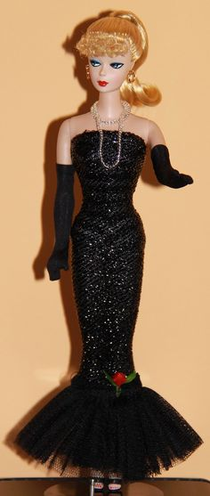 I had this Barbie dress when I was a girl.  I loved this one.  (Notice that you can see the striped bathing suit underneath the dress, heh heh.)  I had this Barbie, with the ponytail, too.
