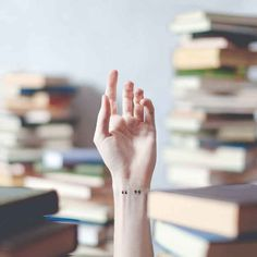 And a piece of books. OMG THATS WHAT I WAS LOOKING FOR: a small tattoo to represent ALL books I love