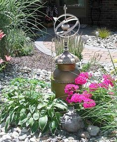 how to camouflage an ugly well pipe, landscape, fire pit, How do you camouflage an ugly well pipe Cut out the bottom of an old milk can and place it over top Easy Well Pump Cover, Metal Desk Makeover, Old Milk Cans, Garden Shelves, Garden Lamps, Garden Art, Garden Design, Outdoor Living, Outdoor Decor
