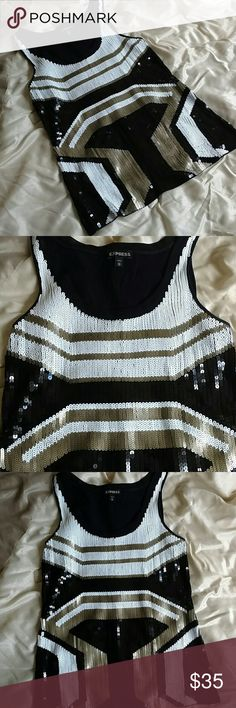 Stunning Sequin Express Tank! This stunning sequin tank is from Express and it's in excellent condition! All sequins are in tact! Never worn and gorgeous!  Black, white, and gold. Size XS  60% Cotton  40% Modal Express Tops Tank Tops