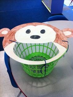 Created a huge monkey face on poster board. Cut out a big mouth and tied it to the top of a laundry basket for an easy and fun bean bag toss game.