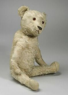 White Mohair Teddy Bear, c. 1920s, brown glass eyes, horizontal woven brown nose, excelsior stuffed.
