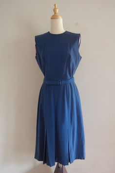 Two long rectangles sewn together with slits for neckline and arms, tied at weist