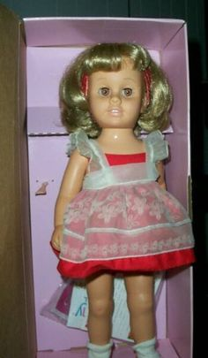Chatty Cathy- I had one similar to this one. I think mine had a red velvety dress. Gosh I loved her- I think my mom threw her in the trash during one of her cleaning frenzies. ugh!