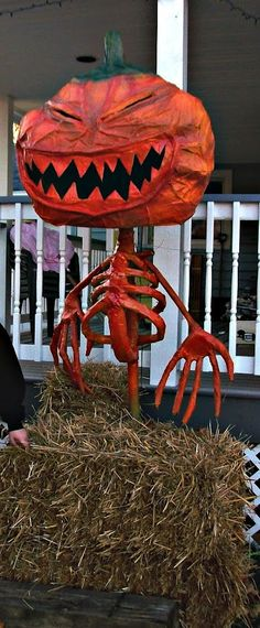 chicken wire and paper mache' Halloween pumpkinxe. A red light bulb inside the head really brings it to life.