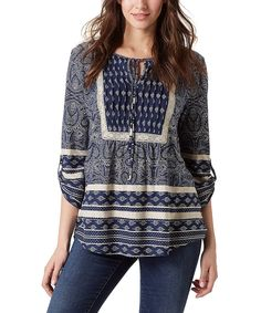 Go boho with this tunic boasting a lively print and puffed sleeves. Its cotton-blend fabric and tab sleeves keep you comfy from season to season.60% cotton / 40% modal exclusive of decorationMachine wash; tumble dryImported