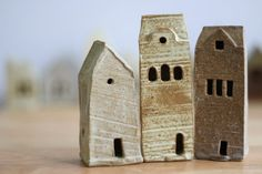 Set of 3  of individually handmade decorative stoneware little houses.  A tiny village of ceramic cottages.