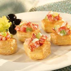 Tasty lobster salad is tucked into golden puff pastry cups for a delicious appetizer that's simply irresistible! Lobster Appetizers, Puff Pastry Appetizers, Lobster Recipes, Puff Pastry Recipes, Yummy Appetizers, Appetizer Recipes, Puff Pastries, Holiday Appetizers, Seafood Recipes